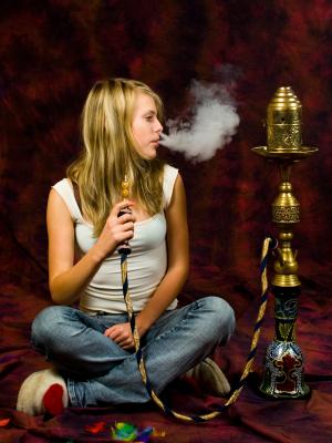 Girl smoking hookah pipe